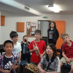 JWA intermediate combo young musicians aged 8 to 13 posed in a group