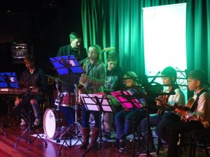 JWA junior combo (jazz band) on stage at Chatswood RSL club, girl soloing on alto sax