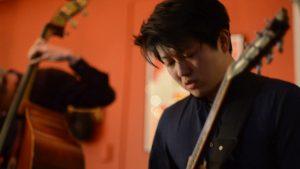 Yutaro Okuda, JWA guitar teacher, performing on stage with his band Yutrio