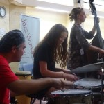 Student bassist and drummer playing
