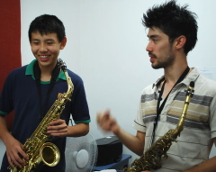 Saxophone student with teacher in his first lesson