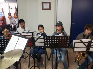jazz band with flute, clarinet, and violin.