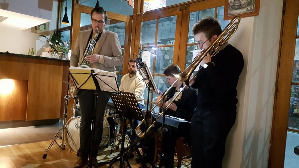 JWA jazz combo for adults playing in a restaurant